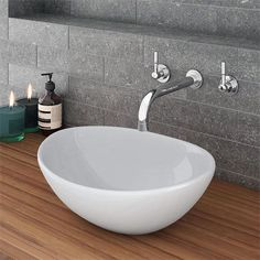 The Runda basin offers contemporary looks at an affordable price. Perfect for those who want to create an ultra-modern bathroom. Tile Counters, Countertop Basin, Cheap Countertops, Concrete Countertops, Kitchen Countertops, Wall Mounted Taps, Wooden Counter, Copper Counter, Cement Counter