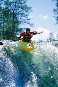 cc80c6bb9ac40 Young Man Kayaking On Waterfall Stock Image - Image of image, canoe: 6077563