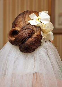 This veil is inserted under the bride's up do. Beautiful with flowers.