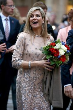 Queen Maxima Photos - Queen Maxima of the Netherlands reacts to bystanders as she crosses Marienplatz on April 13, 2016 in Munich, Germany. King Willem-Alexander and Queen Maxima are on a two-day visit in Bavaria to strengthen the relationship between Bavaria and the Netherlands. - King Willem-Alexander And Queen Maxima Of The Netherlands Visit Bavaria - Day 1