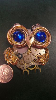 One of a Kind Steampunk Inspired Owl Pendant by Almost Classy designs.   www.almostclassydesigns.com