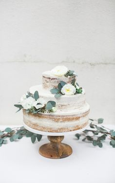 Three-Tiered Naked Wedding Cake with White Flowers