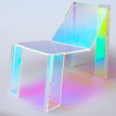 Juliette Mutzke-Felippelli, of Los Angeles-based #design studio @joogii_design, designed a #chair she calls #FrenchTouch that was inspired by French #housemusic from the 90s. Honoring experimental artists like @official_daftpunk, #Cassius, and #Etiennedecrecy, the iridescent chair is made of CNC-cut #acrylic that's covered with #dichroicfilm.