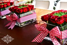 Kentucky Derby Themed Centerpieces.  Red gingham ribbon, red roses and wheat grass. by The Event Shoppe