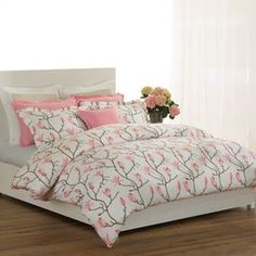The Magnolia Duvet Set freshens a bedroom with its romantic design of blossoming pink flowers against a crisp white background. A modern expression of femininity, this duvet and pillow sham set lends a soft touch to transitional and contemporary decor.   Product: Duvet and 2 shams     Color: Pink, cream, blossom and white birdseye  Features: Adds a fresh, crisp, and romantic touch to your room