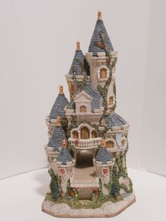 The amazing Guinevere's Castle by sculptor David Winter.  His collections were always the most detailed, intricate, and original on the market.