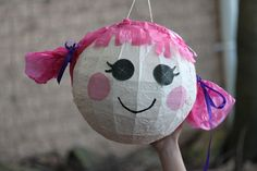 Lalaloopsy pinata - I made it by getting a soccerball pinata and painting it. The eyes are printed from my computer and pasted on. The hair is tissue paper. Super easy! Lalaloopsy party