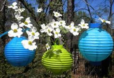 Colorful lanterns with real or artificial flowers are a great way to decorate for a pool party or Luau.  I especially love the blue and green color scheme for a pool party.