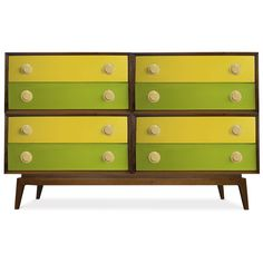 I'm digging this colorful twist on a danish modern dresser... so fun and summery.  Thank you Jonathan Adler!