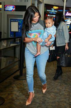 Kim Kardashian's casual, off-duty look, featuring baby North.