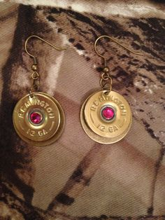 earrings made from spent shotgun shells. different colors of crystals are available. Purple Pink Green Blue Clear Pearl.