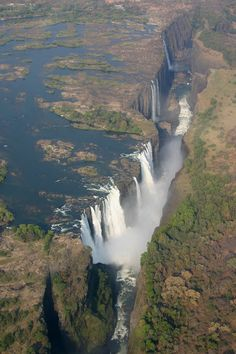 Victoria Falls on the great Zambezi River flowing into a fault line of the earth boarding Zambia and Zimbabwe. Beauty Around The World, Places Around The World, Around The Worlds, Victoria Falls, Great Pictures, Amazing Photos, Adventure Is Out There, Landscape Photos, Beautiful Landscapes