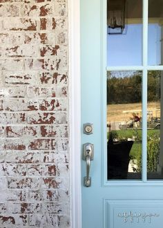 Whitewashed Brick Exterior with a Light Blue French Door /// Woodridge Parade of Homes Tour by Atkinson Drive Door Paint Colors, Front Door Colors, Whitewash Brick House, Whitewashed Brick, Exterior Doors, Exterior Paint, White Wash Brick Exterior, Light Blue Houses, Red Brick Exteriors