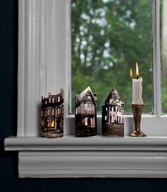 Make a mini ghost town with just paper cutouts of spooky buildings and battery-operated votives