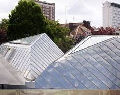 Metallic polygonal roof tops La Madeleine library by Tank Roof Architecture, Contemporary Architecture, Metal Roofing Prices, Gable Window, Standing Seam Roof, Steel Roofing, Modern Traditional, Reading Room, Skylight