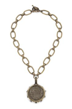 Necklace has 18″ brass chain; Mont Joye medallion with white turquoise, $220
