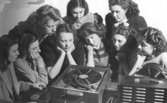 Gathering round the record player, 1950's dstele.com