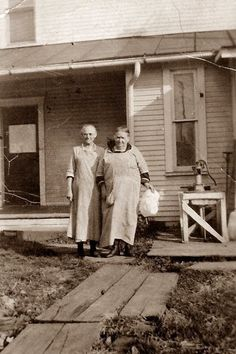 Two Ladies In Front Of Old Farm House. Reminds me of a favorite set of books. Anne of Green Gables.