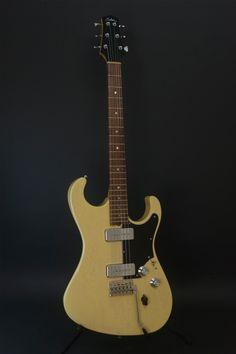 New toy of desire...love the brief, combine a LP junior with a Strat...Bill Asher -Marc Ford Model