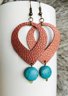 Handmade metallic faux leather earrings with turquoise stone accents. Faux leather comes in deep Copper that shimmers in direct light.  These are VERY lightweight while stil making a statement