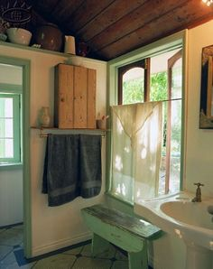 Love the window treatment....and the bench...and the shade of green. Would love to have large swingout windows!
