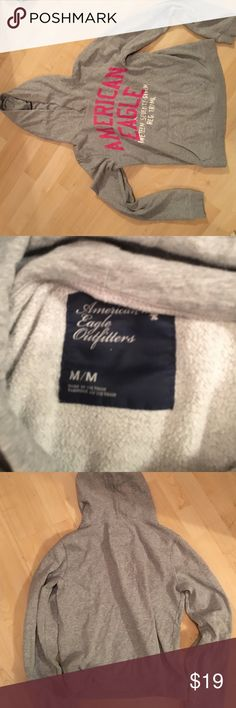 AE Pull Over Hoodie Lightweight, Gray, American Eagle Hoodie with pink and white font. No draw strings. The inside has worn down a bit but there's no staining or holes American Eagle Outfitters Tops Sweatshirts & Hoodies