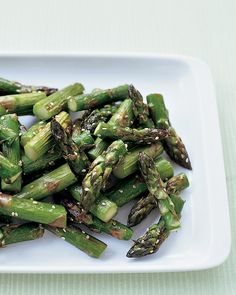 ROASTED SESAME ASPARAGUS In this super-easy recipe, asparagus spears are roasted in a 450-degree oven until they're deliciously browned and sweet. Sesame seeds are added during the last five minutes of roasting to add a crunchy, nutty flavor.