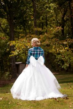 Adorable bride styling with huge bow and plaid flannel! Custom skirt available at Abelina's Boutique. Oklahoma Brides