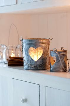 DIY Lanterns -- all you need are some paint cans, a metal-cutting knife, and your Candle Impressions #FlamelessCandles