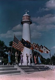 Women hold seven flags at site of historic lighthouse in Biloxi  j baylor roberts Search Results