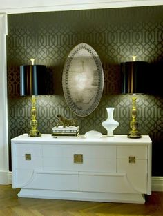 entrances/foyers - Kelly Wearstler Imperial Trellis Wallpaper white Hollywood Regency credenza gold accents gold vintage lamps oval mirror tone on tone black imperial trellis wallpaper