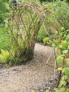 Willow Arbor: Add charm to a landscaped path with a willow arbor made of a bower of branches. From HGTV.com's Garden Galleries