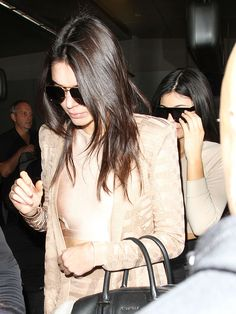 Kendall and Kylie Jenner Arrive in Chic Crop Tops at LAX