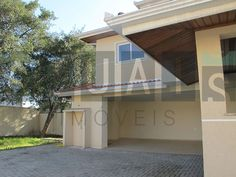 Garagem Coberta  | Casa em Condomínio | São Bras | 4 suítes 420m2 | Quer conhecer? (41) 4106-7799 | contato@atuais.com.br | Whatsapp (41) 9595-0002