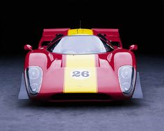 1969 Lola T70 MkIIIb. The Lola MkIIIb was designated as a T70 in order to meet the racing regulations requiring 50 cars that had to be made to qualify for the class. 16 MkIIIb's were made. These photos were taken by master car photographer Don Heiny - http://www.corbisimages.com/photographer/don-heiny