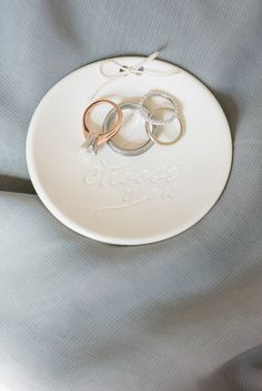 "Mikkel Paige Photography photos of a luxury wedding in NYC. Ring dish from BHLDN with ""I choose you"" and diamond wedding bands and solitaire engagement ring detail picture."