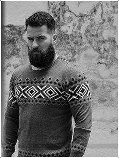 The haircut with thick hair in the middle and little or no hair on the sides and a short beard gives a very serious look.