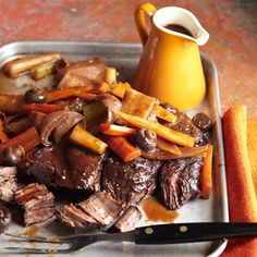 Wine-Marinated Pot Roast: This tender beef creation includes a gorgeous, glossy red wine sauce that amps up sweet root vegetables, mushrooms and onion. More fall recipes: http://www.midwestliving.com/food/holiday/25-fabulous-fall-recipes/