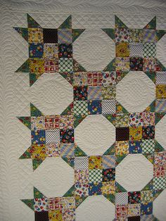 I like the quilting emphasis on the snowball In this traditional snowball and nine patch!