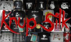 """ESTAMPARIA: Arte final. Telas sob encomenda. Estampas de/em camisas masculinas e femininas (e outros materiais). Fornecemos as camisas ou estampamos a sua própria. Personalizamos e estampamos a sua ideia: imagem, foto, frase ou logo preferido. Envie a sua ideia ou escolha uma das """"nossas"""".... Blog: knupsilk.blogspot... Pagina facebook: www.facebook.com/... twitter.com/KnupSilk"""