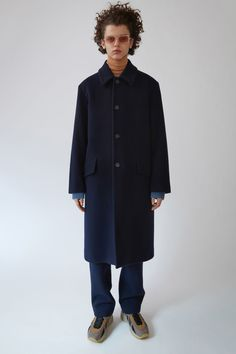 Acne Studios Magma navy is a heritage Loden style coat with extended soft shoulders and tapered sleeves.