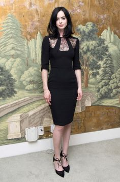 Krysten Ritter in Reem Acra, the dress is fitted through the waist and hips which is quite flattering.