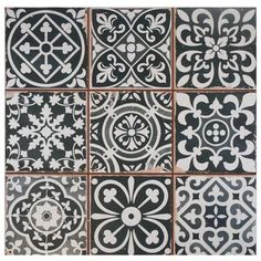 These ceramic floor tiles from SomerTile feature an assembly ofgray and white…