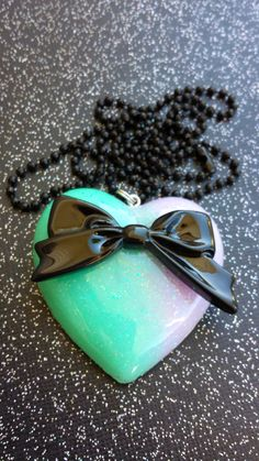 Pastel Goth Bow Pendant - Sweet Lolita Jewelry - Gothic Lolita Necklace - Resin Bow Pendant - Black Bow - Ombre Colors - Pastel Accessory by CultBLACK on Etsy https://www.etsy.com/listing/204754618/pastel-goth-bow-pendant-sweet-lolita