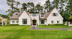 greyton lane - This grand home's light-colored stucco is warmed with light slate-colored shutters and accented with steel doors and windows. Ranch Exterior, Exterior Homes, Steel Doors And Windows, Grand Homes, House And Home Magazine, Shutters, House Colors, Slate, Paint Colors