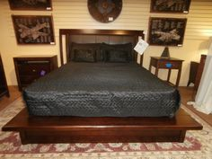 American Drew platform bed in a deep espresso. Queen size. Just add your mattress. Arrived: Thursday September 8th, 2016