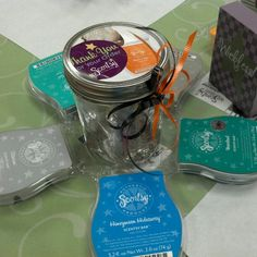 I used mason jars with 4 Scentsy Party Testers inside. I stood the testers on their sides so the #Scentsy label could be seen. I used older/discontinued testers. A way to decorate the lids is to use outdated product sheets or stickees. Tie a ribbon and boom, instant #table #decoration ! This was for our #teacher appreciation #luncheon 2013.