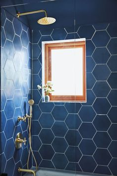 Oversize blue tiles in the guest bathroom (a bookend to Hernández and Leigh's… - Modern Bathroom Interior, Modern Bathroom, Master Bathroom, Bathroom Bin, Minimalist Bathroom, Bathroom Cabinets, Bathroom Showers, Glass Bathroom, Modern Minimalist