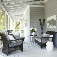 Love the gray and white contrast on this screened in porch