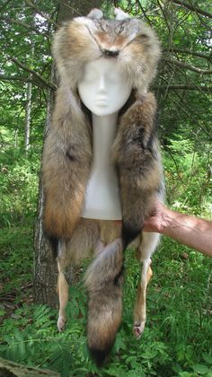 Coyote Pelt Hat. I need to learn how to make these